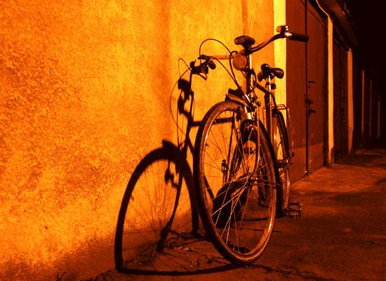 Bicycle in a dark alley