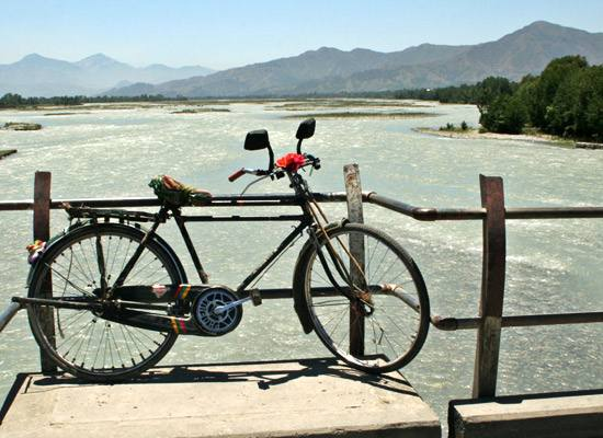 Bicycle, lake and mountains