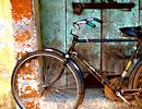 Bicycle against an old door